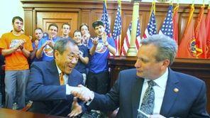 New York Islanders owner Charles Wang and Nassau