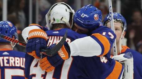 Islanders goalie Robin Lehner and Matt Martin hug