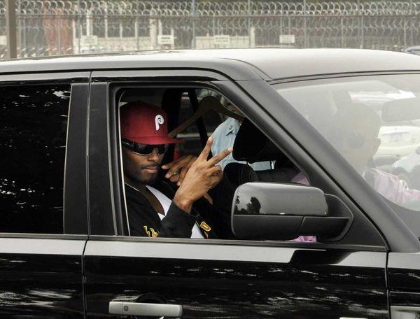 Former New York Giants star Plaxico Burress gestures