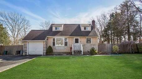 This Central Islip Cape, for $260,000, includes four