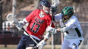 Cold Spring Harbor's Skylar Wenger works the ball