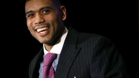 Allan Houston speaks after being honored during the