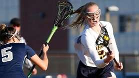 Kristina Kallansrude #22 of Jericho battles for the