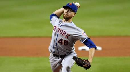 The Mets' Jacob deGrom pitches against the Marlins
