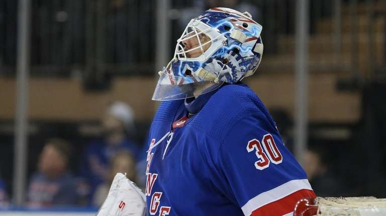 Rangers goalie Henrik Lundqvist reacts during the second