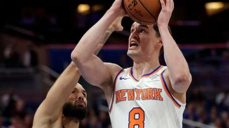 The Knicks' Mario Hezonja goes up for a