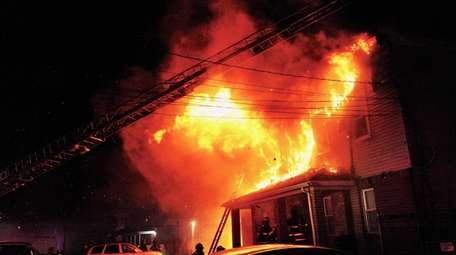The fire rages on Linden Avenue Wednesday night.