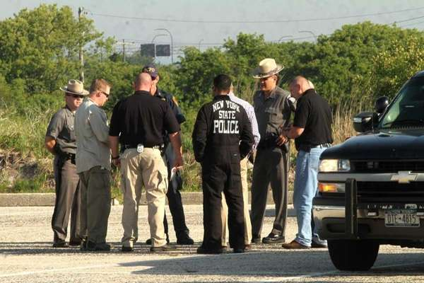 State and Suffolk police gather at staging area