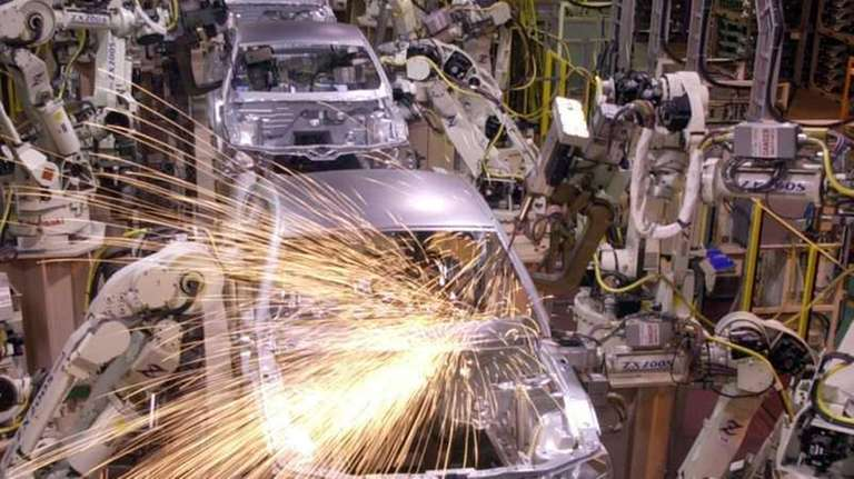 Assembly-line robots weld the 2005 Ford Mustang at