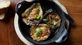 Char-grilled oysters with garlic butter and Parmesan at