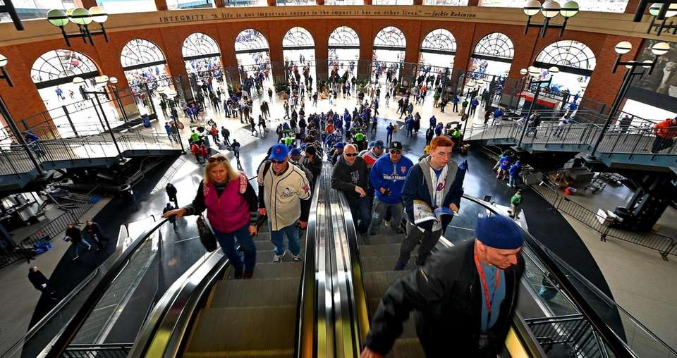 New York Mets fans go up the escalators