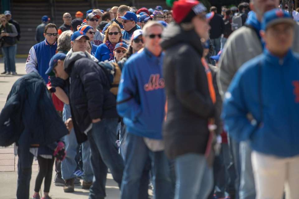 Mets fans wait in line for today's Mets