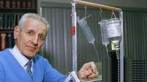 In a 1991 photo, Dr. Jack Kevorkian shows