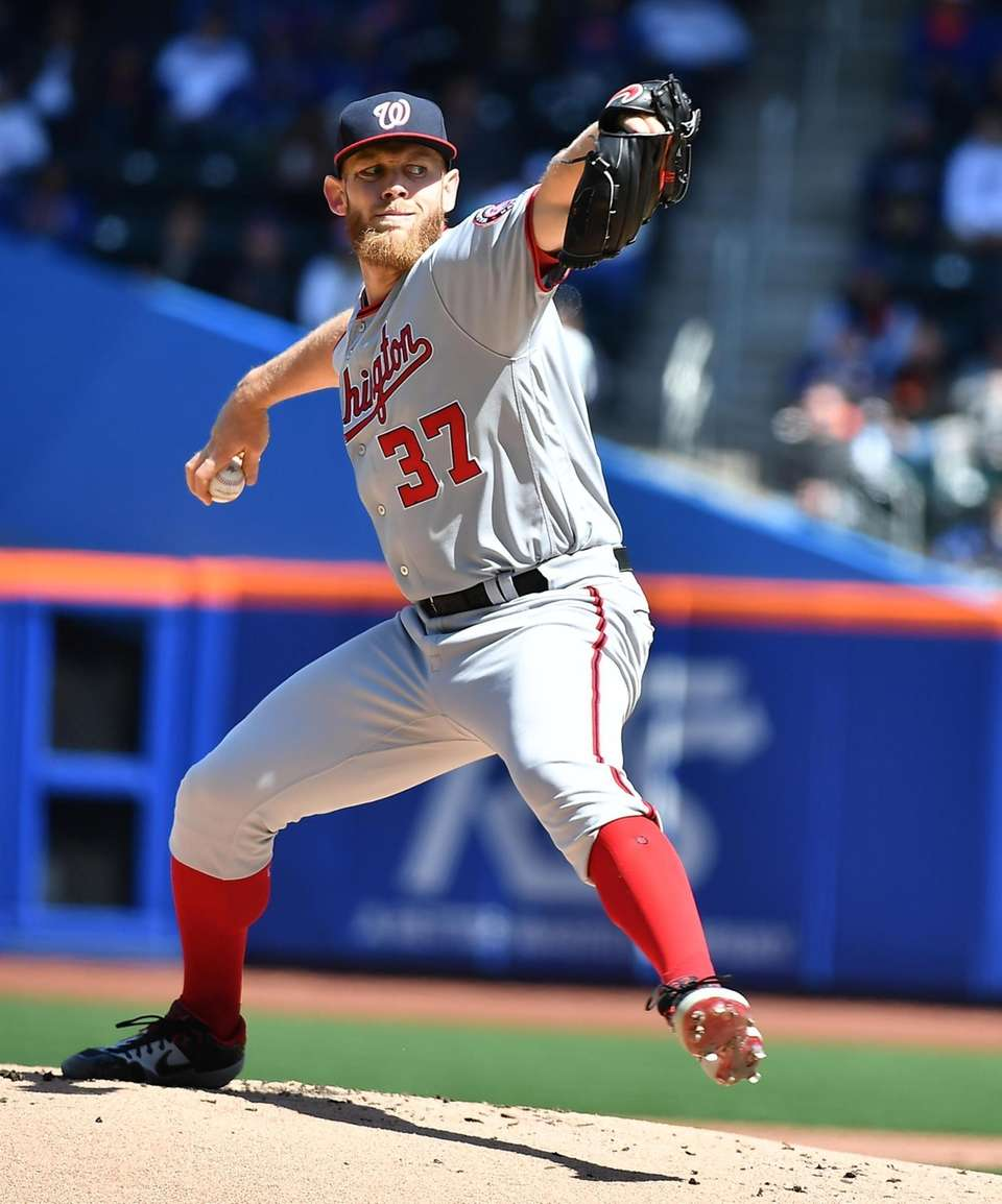 Washington Nationals starting pitcher Stephen Strasburg (37) delivers