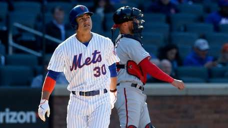 Michael Conforto of the Mets strikes out during