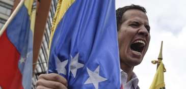 Juan Guaido, president of the National Assembly, yells
