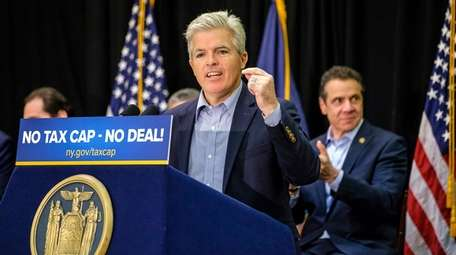 Suffolk County Executive Steve Bellone speaks after Gov.