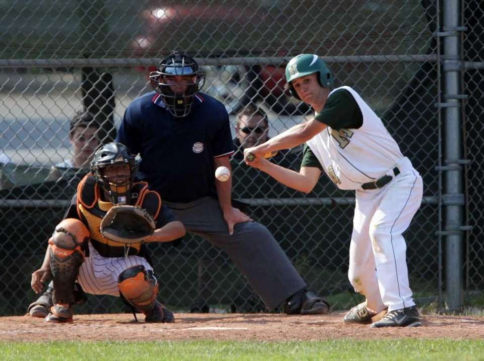 Mercy's shortstop Keith Schroeher (24) follows a pitch