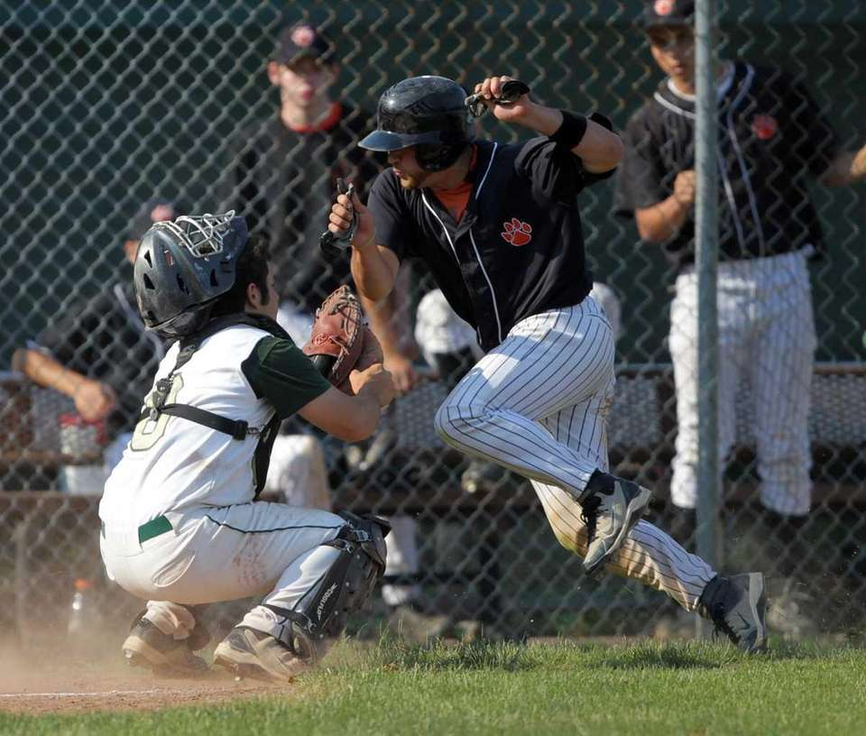 Mercy catcher Rocco Pascale (8) puts the tag