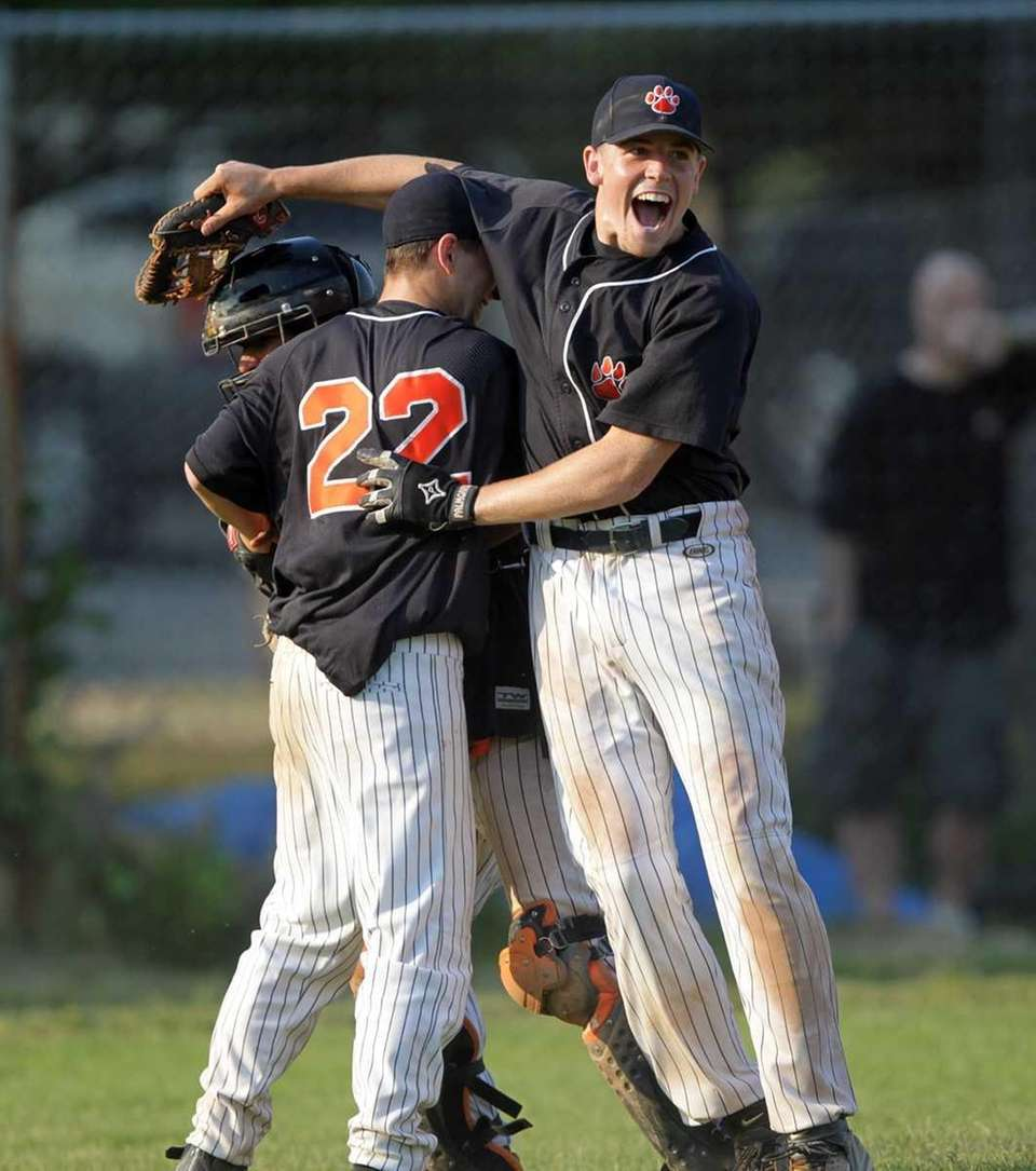 Tuckahoe players celebrate after defeating Mercy in the