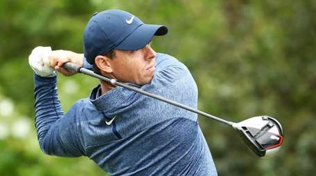 Rory McIlroy plays his shot from the 15th
