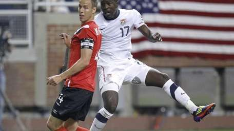 Jozy Atltidore, right, of the United States watches
