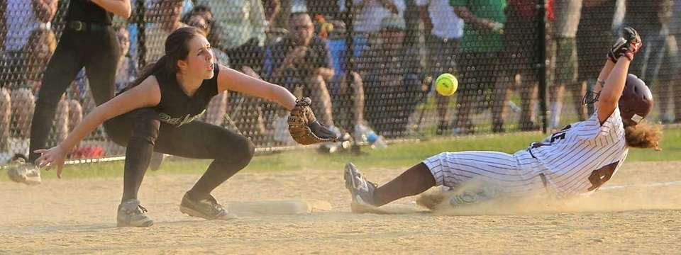 Bay Shore's Briana Coan #44 slides safely into