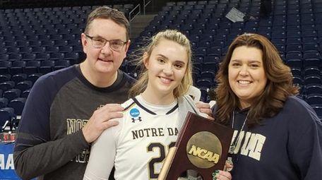Notre Dame freshman Danielle Cosgrove, center, holds the