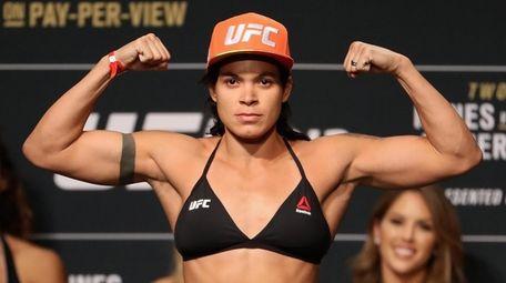 Amanda Nunes of Brazil poses on the scale