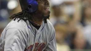 New York Mets' Jose Reyes watches his two-run