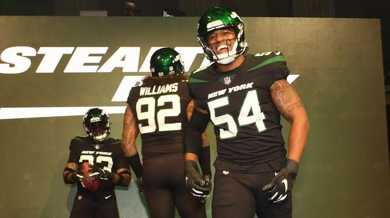 "Jets players show off the ""Stealth Black"" uniforms"