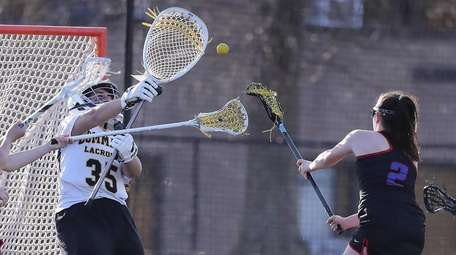 Commack's goalkeeper Cat Deutsch (35) with a save