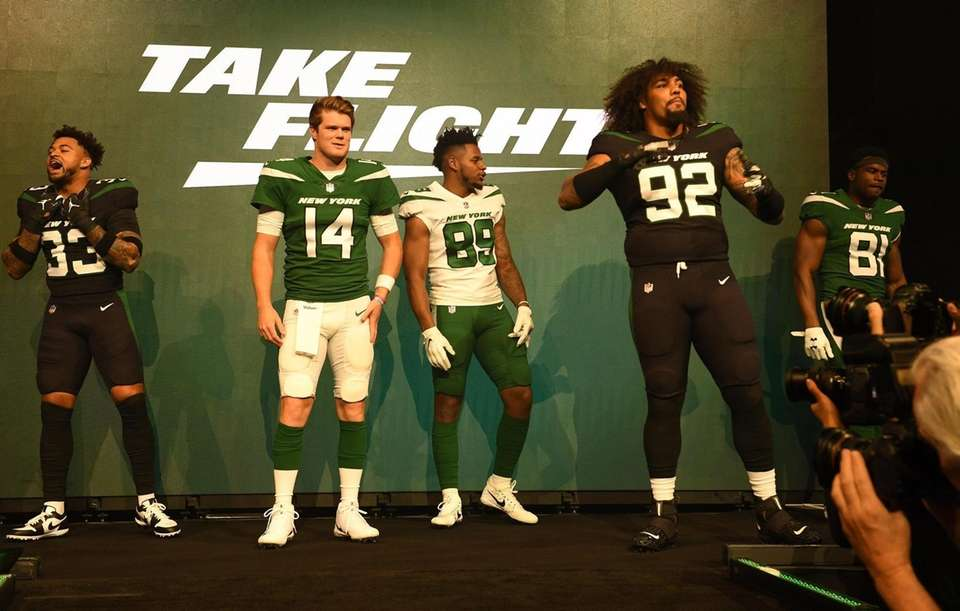"New York Jets players show off the ""Gotham"