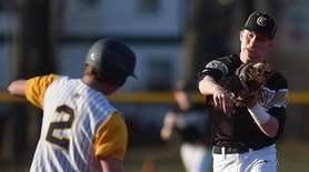 Pat McNelis #22, Commack second baseman, throws to