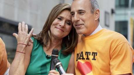Meredith Vieira leans on the shoulder of her