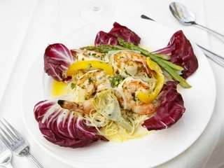 Gamberi alla griglia, grilled shrimp, is served with