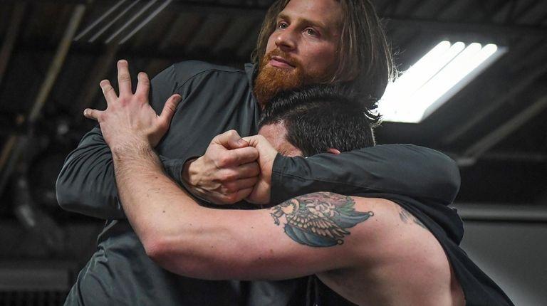 Hawkins, left, wrestles John Caruso at Create A