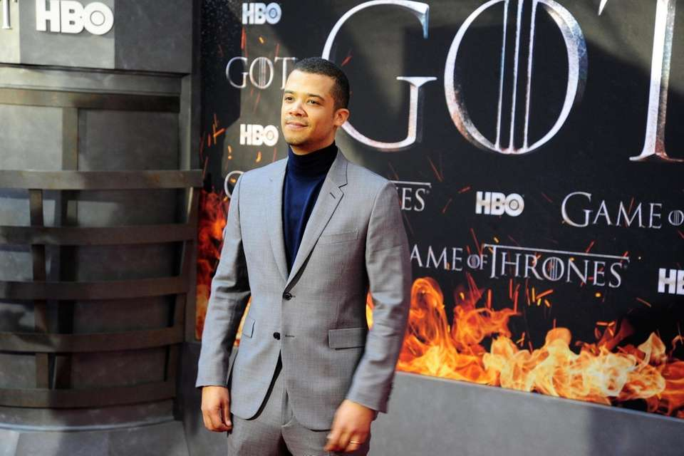 Jacob Anderson poses on the carpet. *** Local