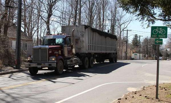 A truck from Beaver Industries drives down East