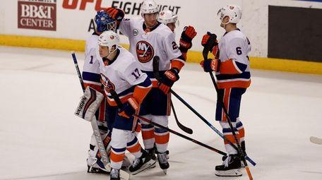 Islanders center Brock Nelson (center) celebrates with teammates