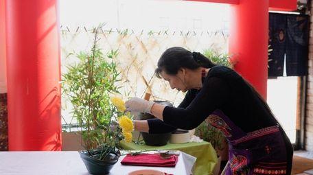 Alma Davis-Carlin works on her design during an