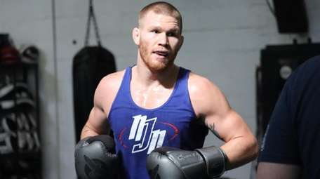 Huntington's Matt Frevola hits pads on Thursday, Oct.