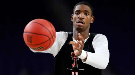 Texas Tech's Tariq Owens warms up during a