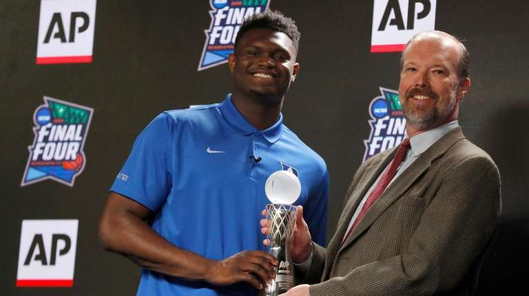 Duke freshman Zion Williamson, left, is presented The