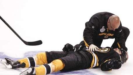 Bruins right wing Nathan Horton is tended to