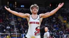 South Side's Kyle Mosher celebrates victory over Penfield's