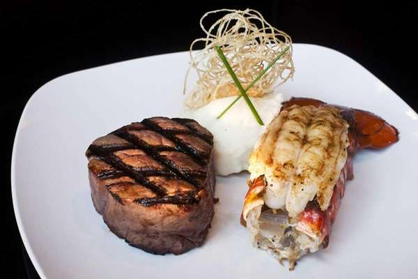 Filet mignon served with a Maine lobster tail