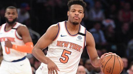 New York Knicks guard Dennis Smith Jr. dribbles