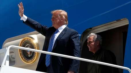 President Donald Trump greets people after he arrived