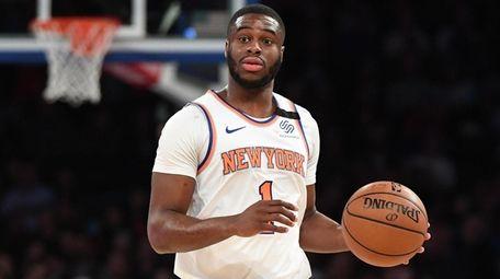 Knicks guard Emmanuel Mudiay brings the ball upcourt